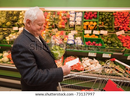 a senior shopping for food in the supermarket