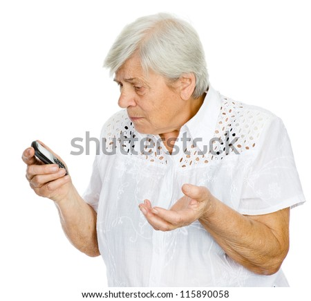 A senior woman stares stunned at something she sees on her smart-phone.  isolated on white background