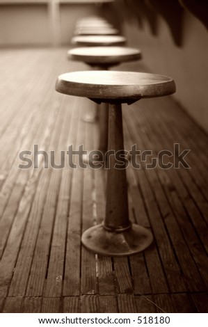 a sepia image of empty stools...