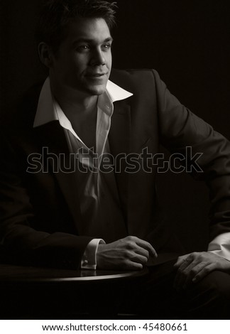 a sepia toned low key dramatic bar scene of a young man in 1930s dress