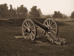 A sepia toned photo of a historic revolutionary war cannon on display at Valley Forge National Historic Park.