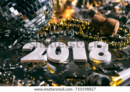 A series celebrating New Year\'s Eve, some with 2018 numerals.  Lots of confetti, champagne, etc. Good for background of ads.