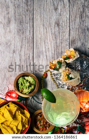 A series of background images for Cinco De Mayo fiesta celebrations.  Margaritas, tacos, serape, lights, and more.  Very festive. #1364186861