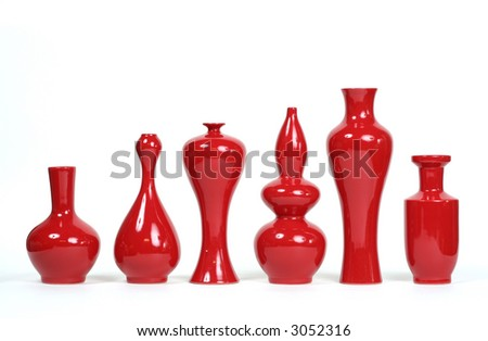 A series of chic red curved vases