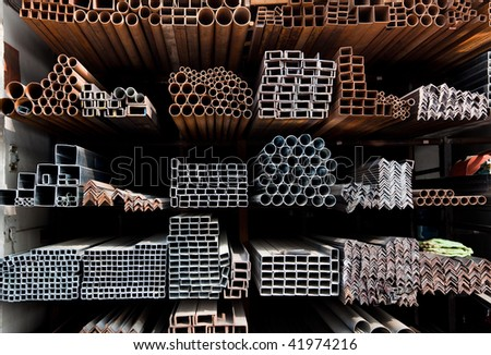 A series of different sizes metal pipes on  shelf