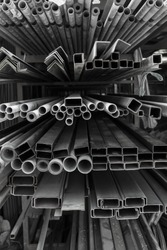A series of different sizes metal pipes on shelf Metal pipe stack on shelf