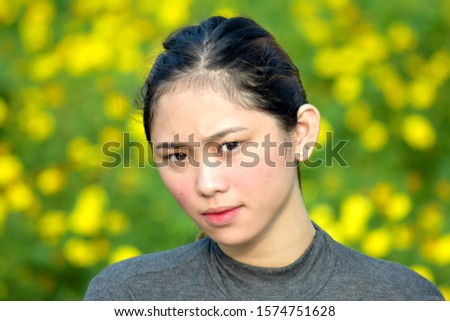 A Serious Adult Asian Female