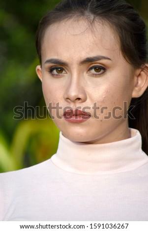 A Serious Beautiful Minority Female