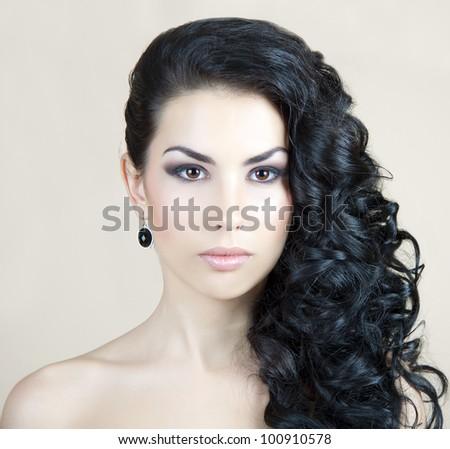 A serious girl with long beautiful hair