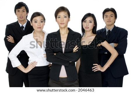 A serious young business team standing on white background