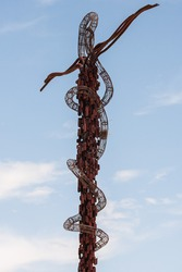 A serpentine cross atop Mount Nebo in Jordan symbolizing a bronze cross that Moses made in the wilderness.