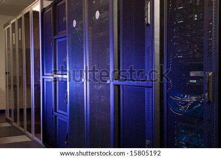 A server room with racks and computer terminals