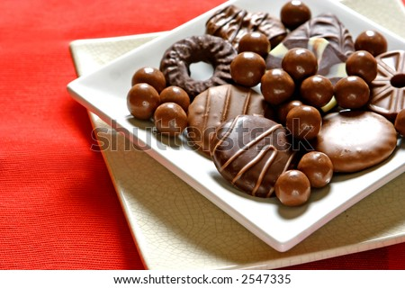 A serving of assorted chocolate biscuits and chocolate treats.