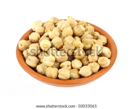 A serving of dried garbanzo beans in a small terra cotta bowl