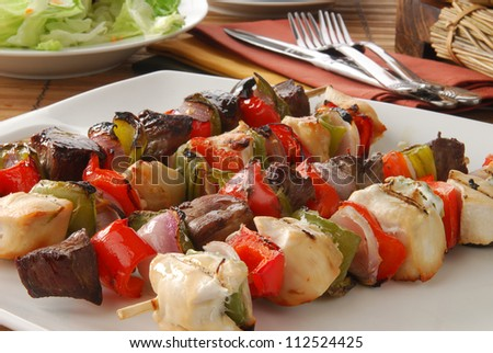 A serving platter of beef and chicken shish kebabs
