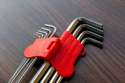 A set of allen, hex keys,Allen key or Hexagonal key also called inbus lock is a key used to install and remove hexagon bolts