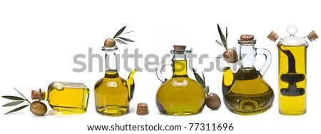 A set of bottles of olive oil.