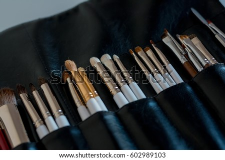 A set of brushes for make-up is on the table #602989103