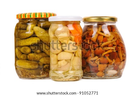 a set of canned vegetables. cucumbers, mushrooms and carrots. isolated