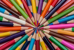 A set of colored pencils. Laid out in a circle, background from pencils