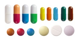 A set of different pills isolated on white background.