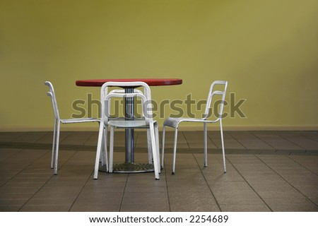 A set of dining table and chairs - stock photo