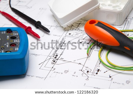 A set of electrical instruments laying on blueprint