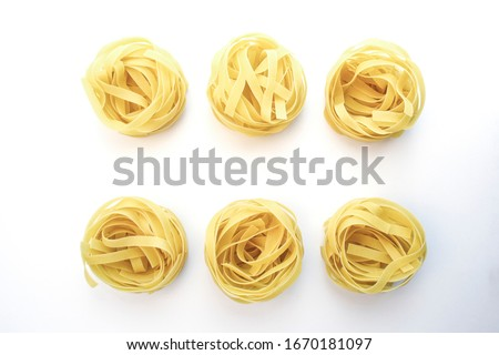 A set of fettuccine 6 pieces, filled with farfalle, penne, snail, rotini, rolls, tortillas embedded in an oval, pasta isolated on a white background, top view in high quality.