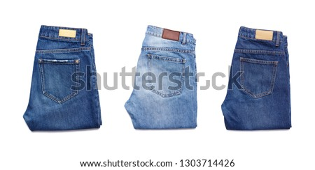 A set of folded jeans isolated on white background.