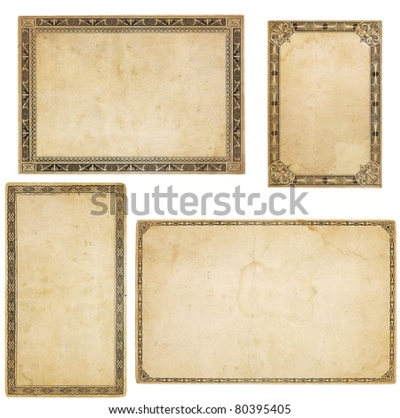 A set of four heavily aged blank cards with stains, creases and tears.  Each card has different, old-fashioned decorative border. Isolated on white. Includes clipping paths.