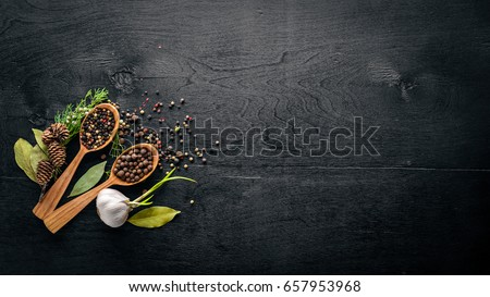 A set of fragrant spices. A mixture of black and red pepper, coriander, paprika. On Wooden background. Top view. Free space. #657953968