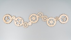 A set of gears made of natural wood puzzle. Stacked into a single mechanism