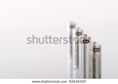 a set of generic AA batteries, lined up