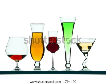 A set of glasses with colorful liquids inside