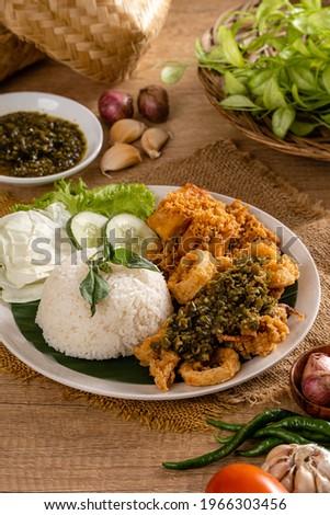 A Set of green chili fried squid with indonesian Spicies or A set of 'Cumi Goreng Sambal Hijau '. Cumi Goreng Sambal Hijau is Indonesian cuisine.  Stock fotó ©