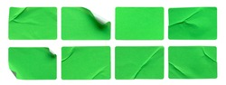 A set of green rectangular paper sticker label isolated on white background.