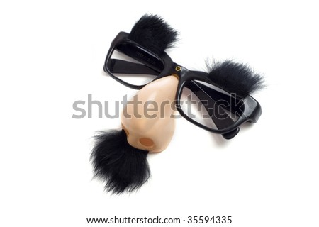 """A set of """"Groucho Marx"""" glasses with nose, mustache and eyebrows on a white background.  Funny glasses with nose"""