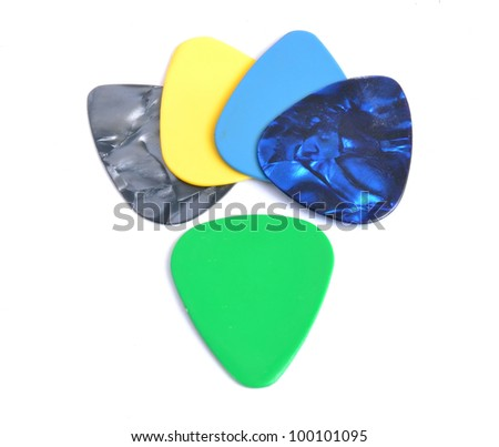 A set of guitar picks on a white background