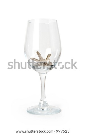 A set of keys in a wine glass symbolizing drinking and driving.