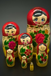 a set of 7 matrioshka dolls isolated on dark background