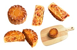 A set of moon cakes full and slices isolated in white background, moon cakes with clipping path, no shadow, Chinese Mid Autumn Festival