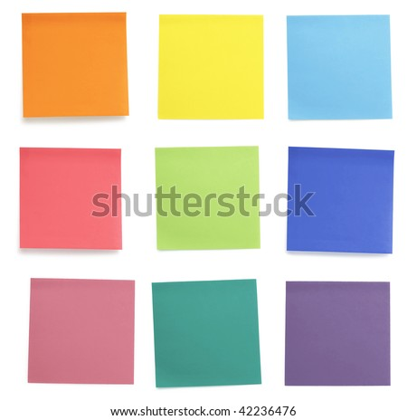 A set of office/work related rainbow colored paper sticky notes. Isolated on cork background.