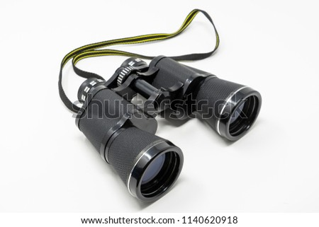 A set of old binoculars set against a white background #1140620918