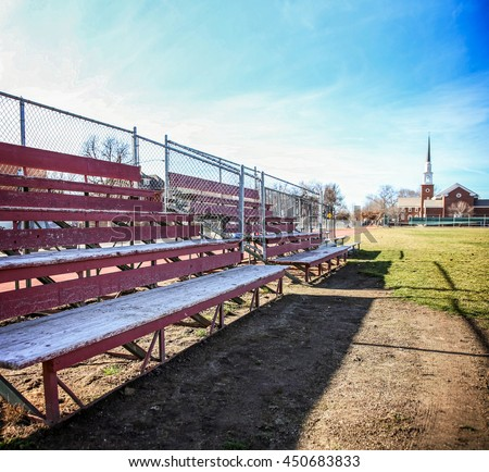 a set of old wooden bleachers for cheering on a sporting event at a local high school toned with a retro vintage instagram filter app or action effect
