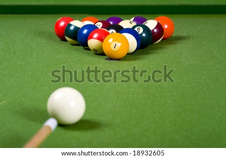 A set of pool or billiard ball on a green felt table