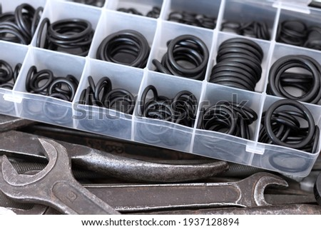A set of rubber O-rings for pneumatics and hydraulics and old locksmith tools. Photo stock ©