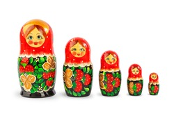 a set of Russian folk wooden dolls covered with patterns, isolate on a white background