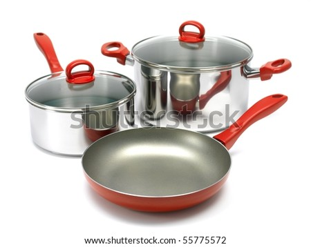 A set of saucepans and a frying pan isolated against a white background