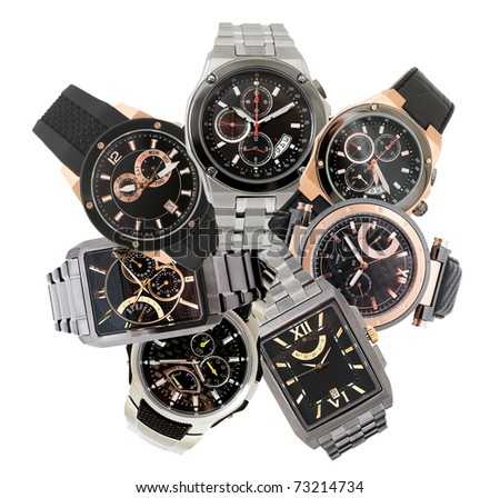 a set of seven different men's watches over white
