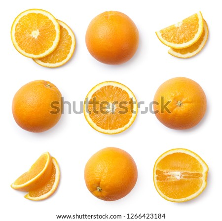 A set of sliced and whole oranges, cut out. Top view.